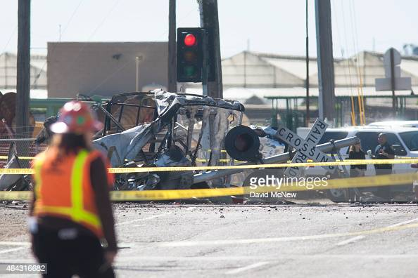 The burned remains of a truck are seen at the site where a Los Angelesbound Metrolink train derailed in a fiery collision with a truck on the tracks...