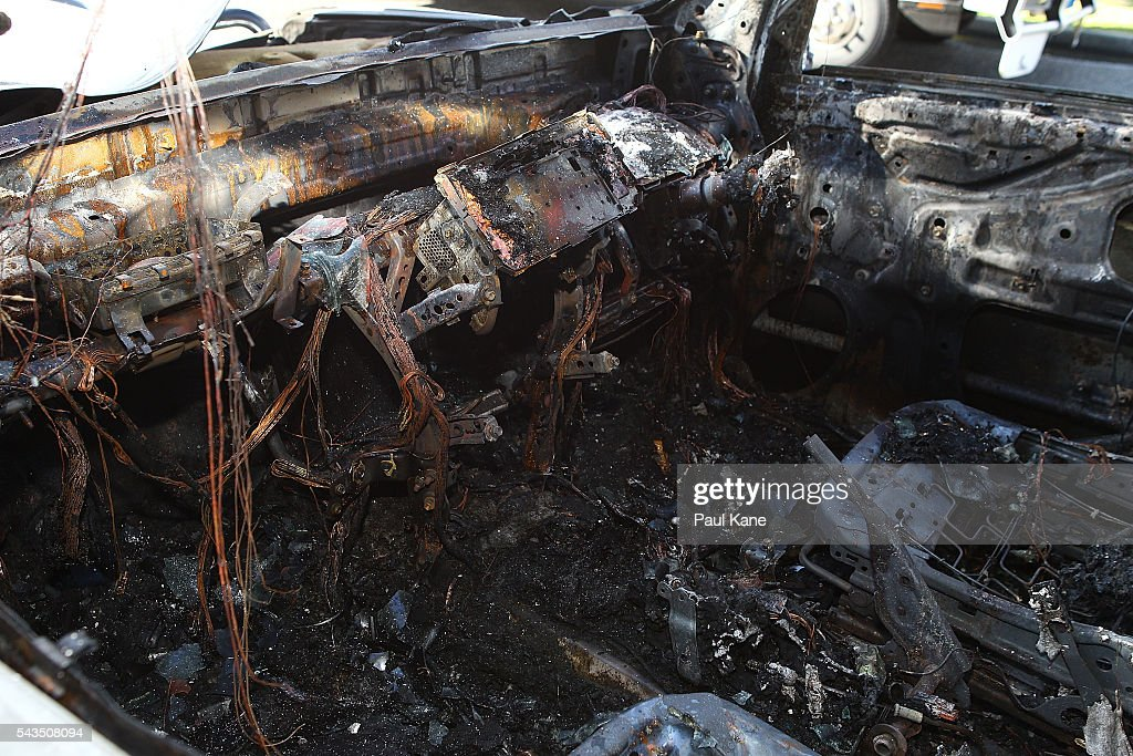 The burned-out Toyota 4x4 is seen prior to being towed away outside Thornlie Australian Islamic College and Mosque on June 29, 2016 in Perth, Australia. Police are investigating a firebomb attack which occurred last night at the Thornlie Mosque. No one was injured in the attack which took place during evening prayers.
