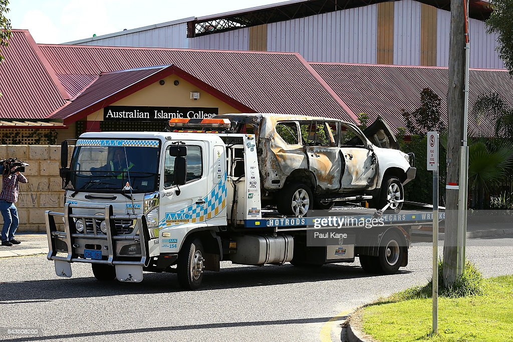 The burned-out Toyota 4x4 is towed away from the Thornlie Australian Islamic College and Mosque on June 29, 2016 in Perth, Australia. Police are investigating a firebomb attack which occurred last night at the Thornlie Mosque. No one was injured in the attack which took place during evening prayers.