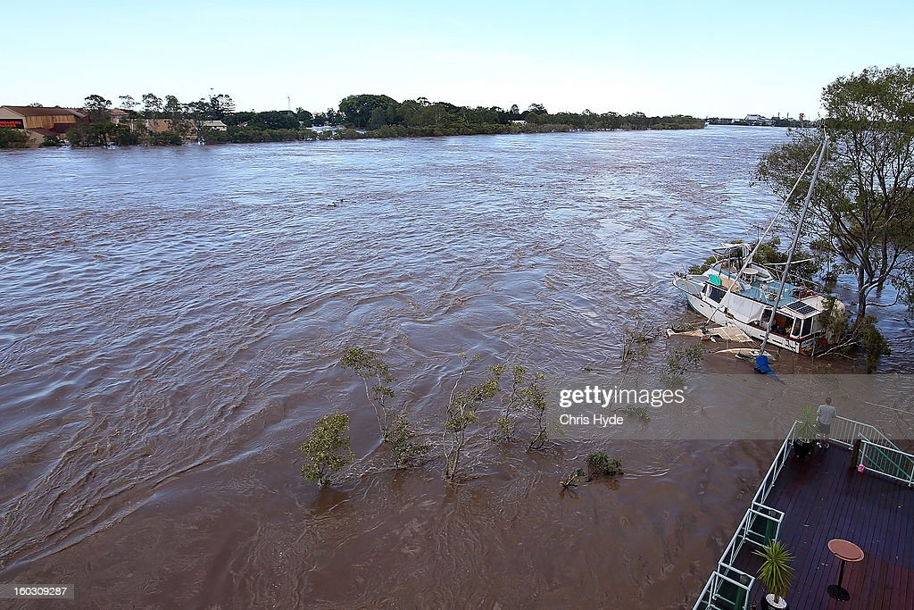The Burnett River rises as parts of southern Queensland experiences record flooding in the wake of Tropical Cyclone Oswald on January 29, 2013 in Bundaberg, Australia.Four deaths have been confirmed and thousands have been evacuated in Bundaberg as the city faces it's worst flood disaster in history. Rescue and evacuation missions continue today as emergency services prepare to move patients from Bundaberg Hospital to Brisbane amid fears the hospital could lose power.