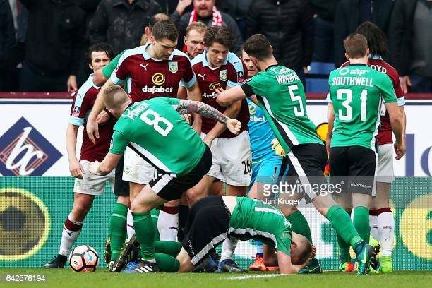 The Burnley and Lincoln City players clash during The Emirates FA Cup Fifth Round match between Burnley and Lincoln City at Turf Moor on February 18...