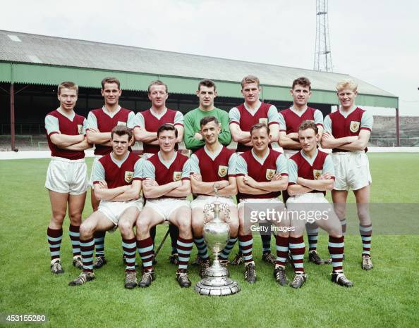 The Burnley Division One championship team of season 195960 pose with the trophy at Turf Moor Burnley