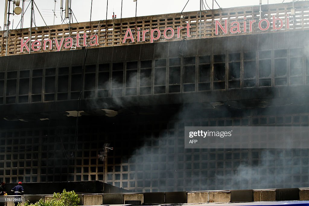 The burnt exterior of the Jomo Kenyatta international airport is pictured in Nairobi on August 7, 2013. A massive fire shut down Nairobi's international airport today with flights diverted to regional cities as firefighters battled to put out the blaze in east Africa's biggest transport hub. AFP PHOTO/Lama Kabbani