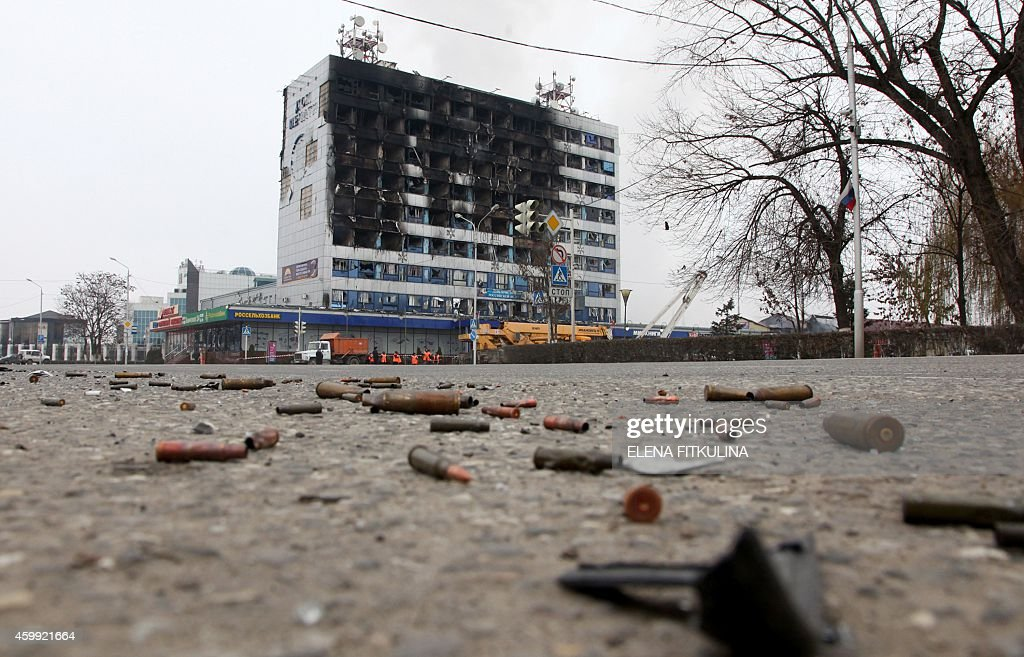 The burnt media building stands in central Grozny on December 4 2014 Several police died in clashes with militants who attacked a traffic post in the...