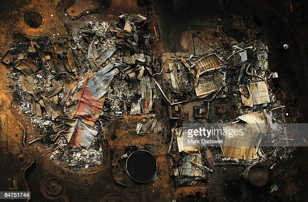 The burnt out remains of a house in the Kinglake region on February 12 2009 in Kinglake Australia Victoria Police have revised the bushfire disaster...