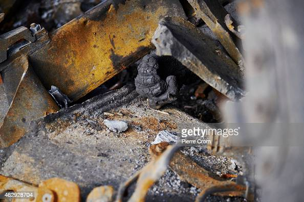 The burnt remains of a Ukrainian soldier protrude from a burntout Ukrainian tank on February 7 2015 in Uglegorsk Ukraine According to ProRussian...