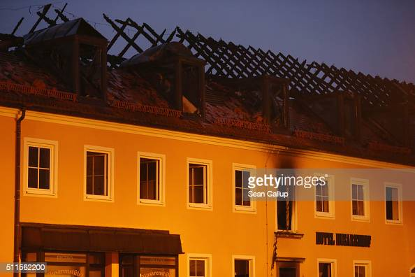 The burntout remains of a former hotel that was to soon serve as a shelter for 300 asylum applicants stand following a fire in the early morning on...