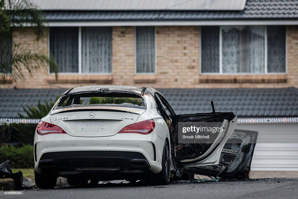 The burnt-out remains of a vehicle used during a shooting at Bankstown Central Shopping Centre on April 29, 2016 in Sydney, Australia. One man has been confirmed dead, with two others injured.