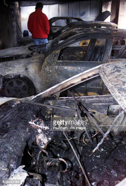 The burntout shells of four priests' cars which were destroyed in Dungannon County Tyrone The blaze was adjacent to the priests' parochial house...