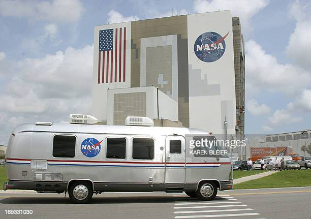 The bus carrying the Discovery astronauts passes the Vehicle Assembly Building 01 July 2006 on the way to launch pad 39B at the Kennedy Space Center...