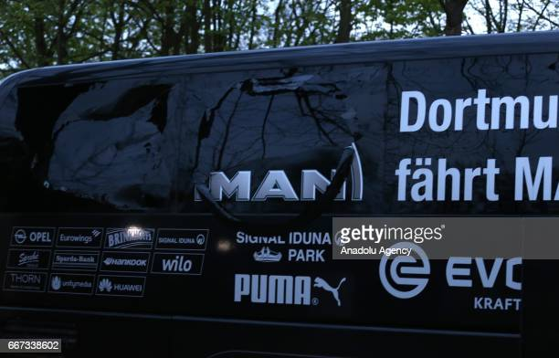The bus of Borussia Dortmund stands after explosions at the hotel L'Arrivee in Dortmund Germany on April 11 2017 The UEFA Champions League...