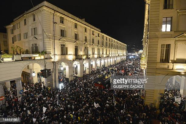 The bus of Juventus football team parades in the streets of Turin to celebrate their Italian Serie A football trophy the Scudetto during a ceremony...