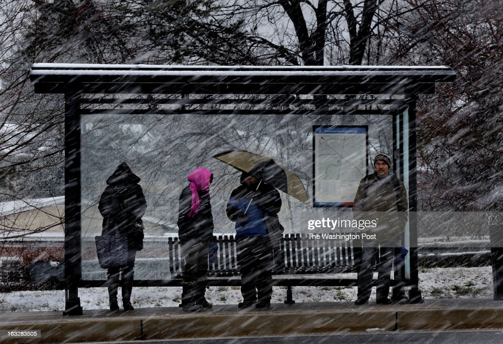 The bus shelter only provided so much protection from the storm as riders waited on Veirs Mill Rd in Silver Spring A slushywet snow storm hit the...