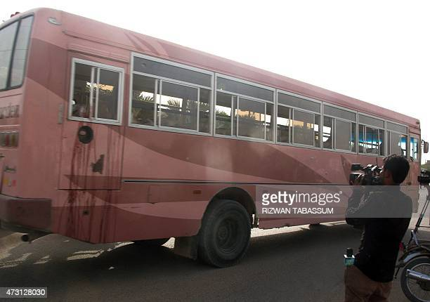 The bus that was attacked as it was carrying Shiite Muslims is parked at a hospital after the assault by gunmen in Karachi on May 13 2015...
