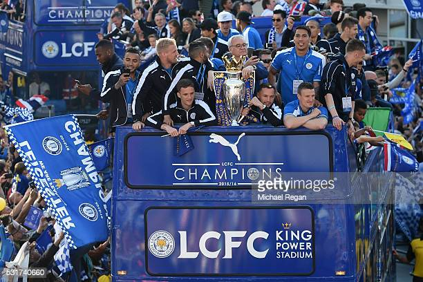 The Buses carrying the Leicester squad and trophy make their way through the the streets during the Leicester City Barclays Premier League winners...