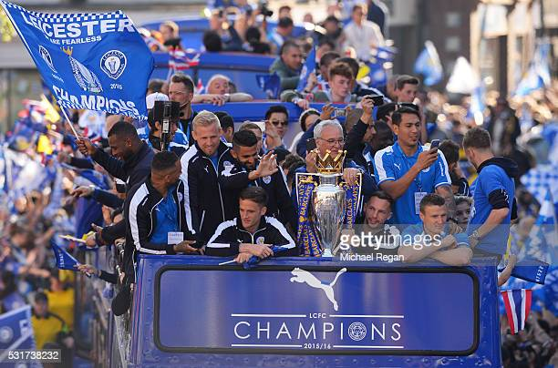 The Buses carrying the Leicester squad and trophy makes it's way through the the streets during the Leicester City Barclays Premier League winners...