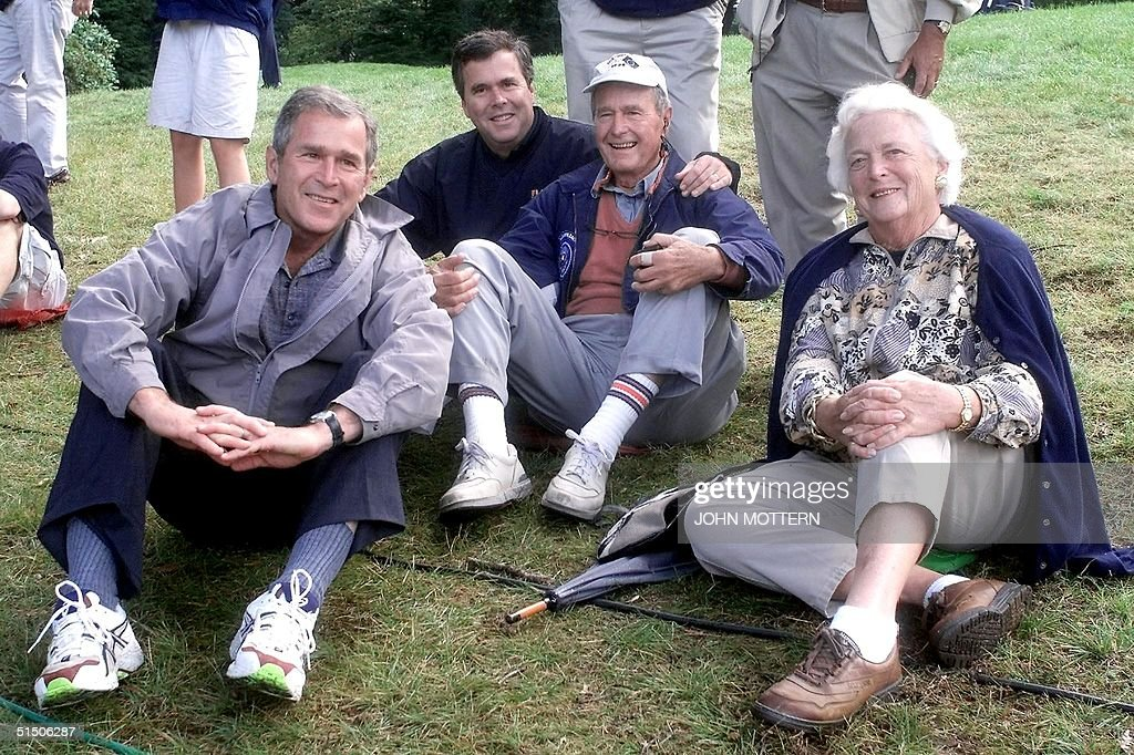 The Bush family Texas Governor and presidential candidate George W Florida Governor Jeb former US president George and his wife Barbara watch play...