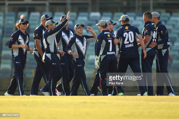 The Bushrangers celebrate the wicket of Ben McDermott of the Tigers during the JLT One Day Cup match between Victoria and Tasmania at WACA on October...