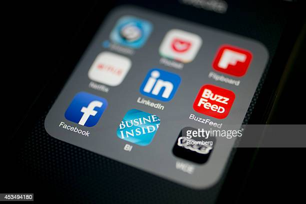 The Business Insider Inc application icon is displayed on an Apple Inc iPhone 5s for an arranged photograph in Washington DC US on Monday Aug 11 2014...