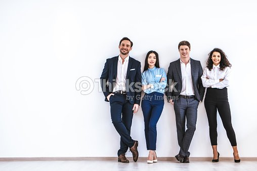 The business people standing on the white wall background : Stock Photo