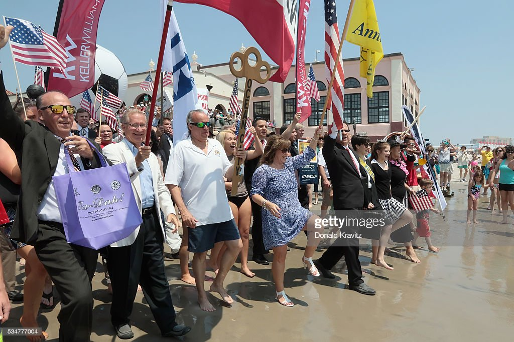 The Business Persons Group marches into the Atlantic Ocean as they participate in The Business Persons Plunge on May 27, 2016 in Ocean City, New Jersey.