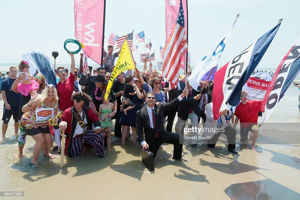 The Business Persons Group marchestheir way out of the Atlantic Ocean as they participate in The Business Persons Plunge on May 27, 2016 in Ocean City, New Jersey.