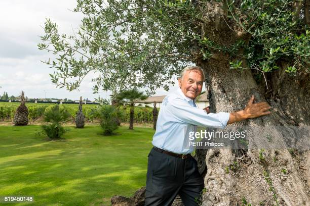 the businessman and winegrower with more than forty vineyards in the world Bernard Magrez poses in the garden of his castle Pape Clément on...