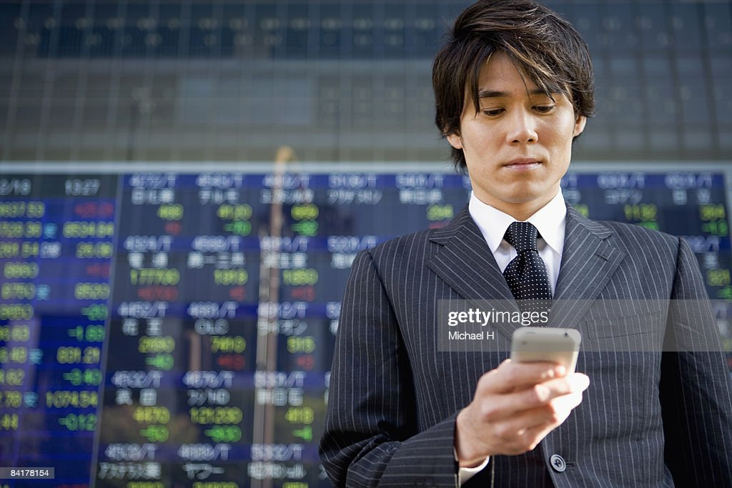 The businessman who confirms the stock prices : Stock Photo