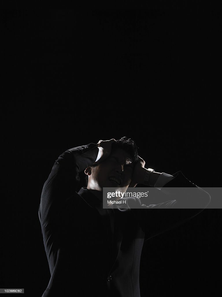 The businessman who was troubled too much : Stock Photo