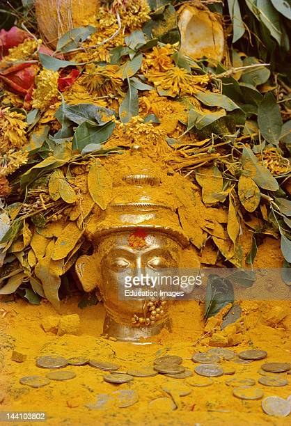 The Bust Of Malshabai Khandoba'S Wife Is Showered With Turmeric Powder Leaves Flowers And Coins By The Devotees Jejuri Maharashtra India