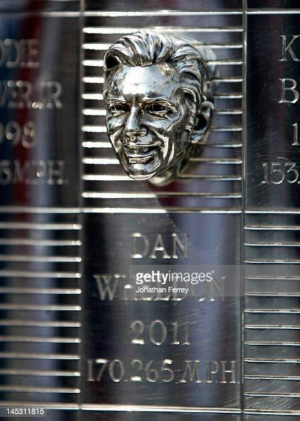 The bust of the late Dan Wheldon adorns the BorgWarner Trophy for his victory at 2011 the Indianapolis 500 while displyed at the driver's meeting...