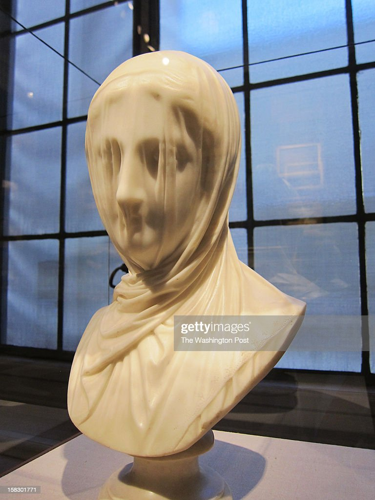 The bust of the woman wrapped in a veil is Giuseppe Croff's 'The Veiled Nun' (c. 1860), on view at the Corcoran Gallery of Art.