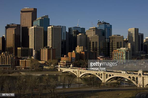 The bustling downtown skyline and Centre Street Bridge situated next to the Bow River is seen in this 2010 Calgary Canada spring morning landscape...