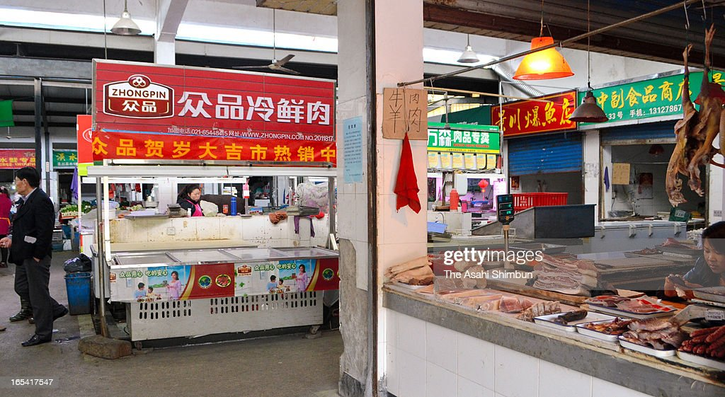 The butcher where a 27-year-old worker died from H7N9 bird flu is seen closed while other butchers are open as usual at a marketplace in the outer suburbs of Shanghai on April 3, 2013 in Shanghai, China. 9 detected and 3 died due to the new strain.