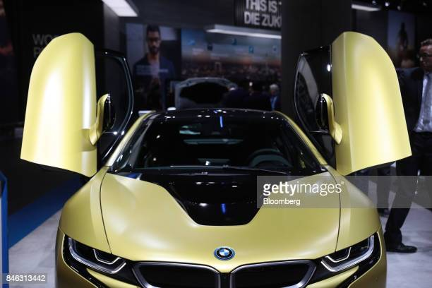 The butterfly doors of a BMW i8 electric automobile manufactured by Bayerische Motoren Werke AG sit open on the first media preview day of the IAA...