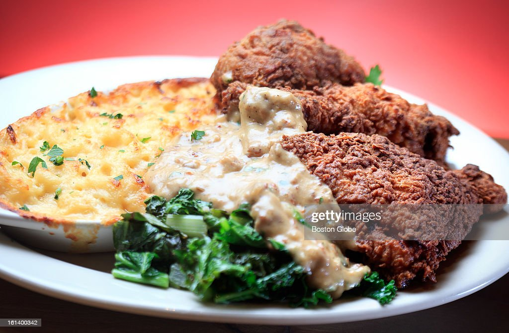 The buttermilk fried chicken with sausage gravy, bacon mac n' cheese and greens, $17.95, from Estelle's Southern Cuisine in Boston.
