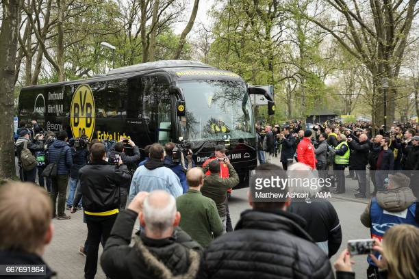 The BVB Borussia Dortmund team bus arrives along a different route to the stadium prior to the UEFA Champions League Quarter Final first leg match...