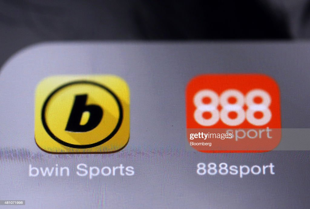 The Bwin.party Digital Entertainment Plc sports betting app, left, and the 888 Holdings Plc sports betting app sit on a smartphone device in this arranged photograph taken in London, U.K., on Friday, July, 17, 2015. 888 Holdings Plc agreed to buy Bwin.party Digital Entertainment Plc for 898.3 million-pounds ($1.4 billion) in cash and shares, winning over the online gaming company that's been at the center of a takeover battle. Photographer: Chris Ratcliffe/Bloomberg via Getty Images