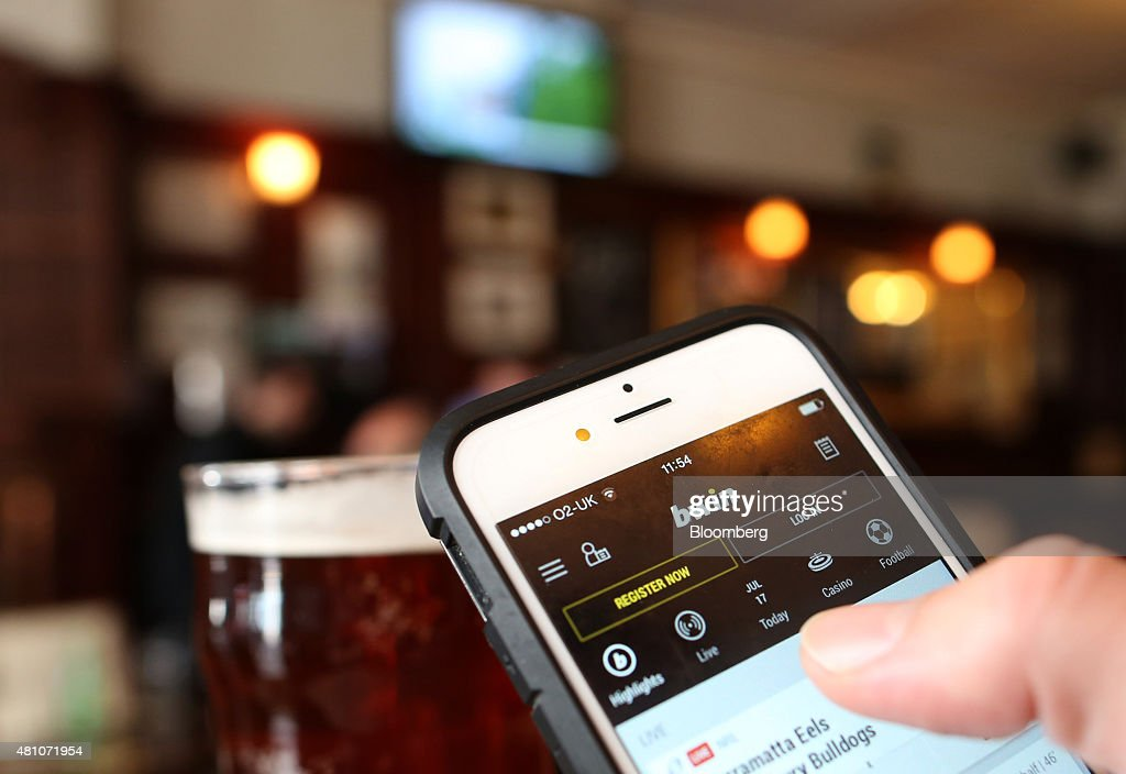 The Bwin.party Digital Entertainment Plc sports betting app sits on an Apple Inc. iPhone 6 in this arranged photograph taken in London, U.K., on Friday, July, 17, 2015. 888 Holdings Plc agreed to buy Bwin.party Digital Entertainment Plc for 898.3 million-pounds ($1.4 billion) in cash and shares, winning over the online gaming company that's been at the center of a takeover battle. Photographer: Chris Ratcliffe/Bloomberg via Getty Images