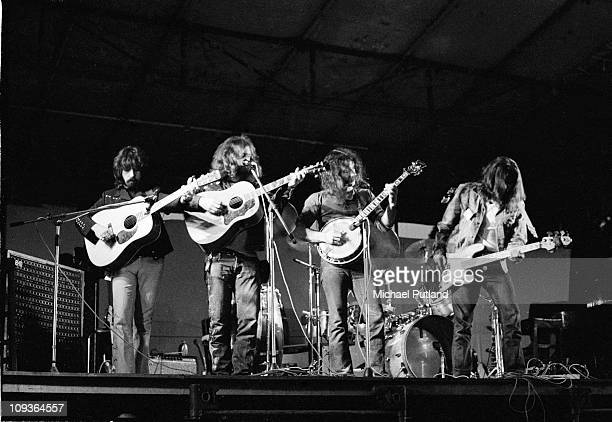 The Byrds perform on stage at Lincoln Festival 24th July 1971 LR Clarence White Roger McGuinn Gene Parsons Skip Battin