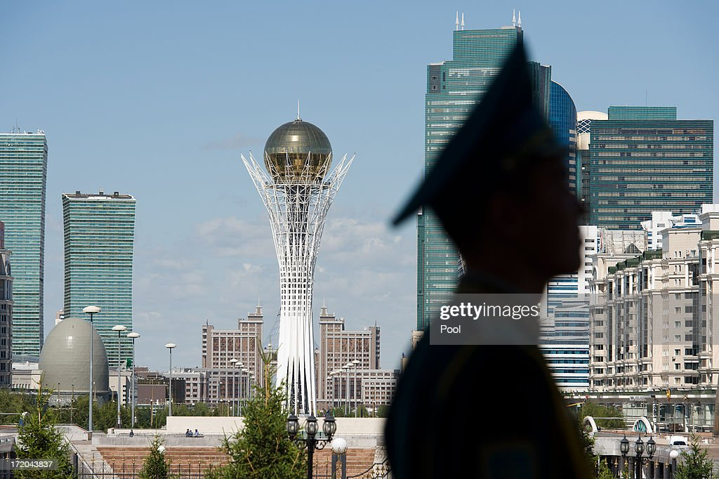 The Byterek Tower is viewed from outside the Presidential Palace as a soldier stands guard while British Prime Minister David Cameron meets with...
