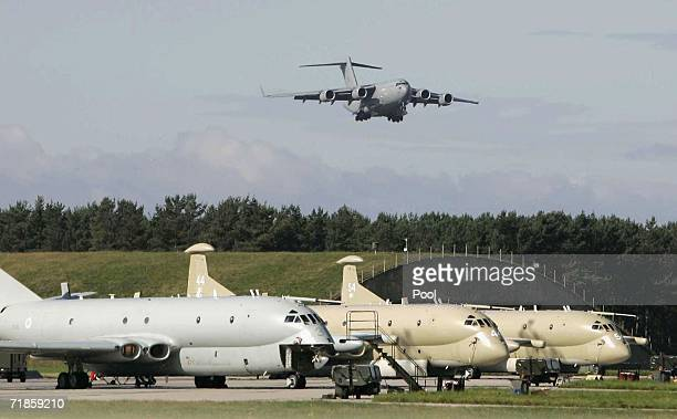 The C17 transport aircraft bearing the bodies comes in to land above a fleet of Nimrod's at RAF Kinloss on September 12 2006 in Kinloss Scotland The...