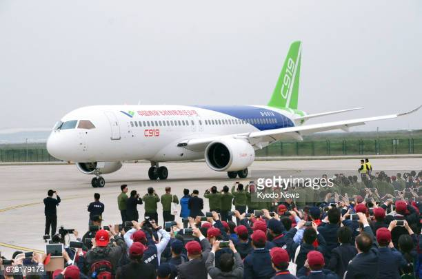 The C919 China's first domestically built jetliner is seen at the Shanghai Pudong International Airport on May 5 after a maiden flight ==Kyodo