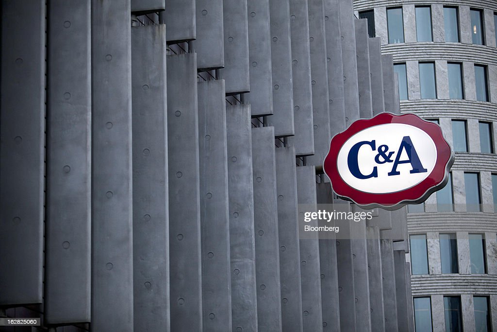 The C&A logo is seen on the outside of a store operated by the C&A Group in Berlin, Germany, on Wednesday, Feb. 27, 2013. German unemployment unexpectedly fell in February amid signs that Europe's biggest economy is returning to growth after a contraction at the end of last year. Photographer: Balint Porneczi/Bloomberg via Getty Images