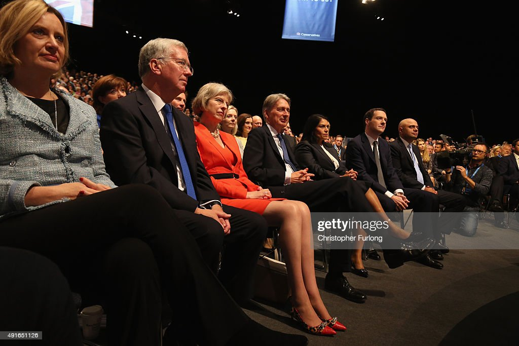 The cabinet listen to Prime Minister David Cameron deliver his keynote speech to delegates on the fourth and final day of the Conservative Party...