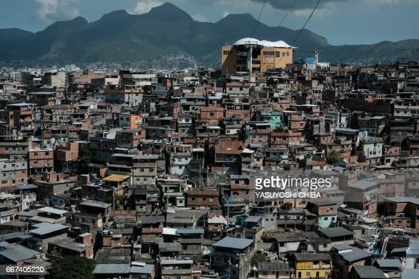 The cable car over the Alemao favela in Rio de Janeiro Brazil seen here on April 3 is no longer running The sixstation mass transit gondola system...
