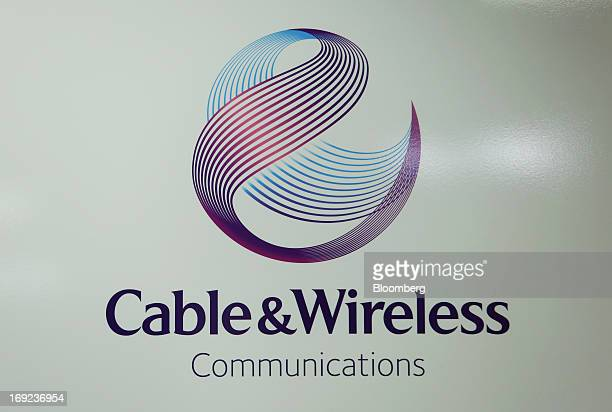 The Cable Wireless Communications Plc company logo is displayed in the reception area at the company's headquarters in London UK on Wednesday May 22...