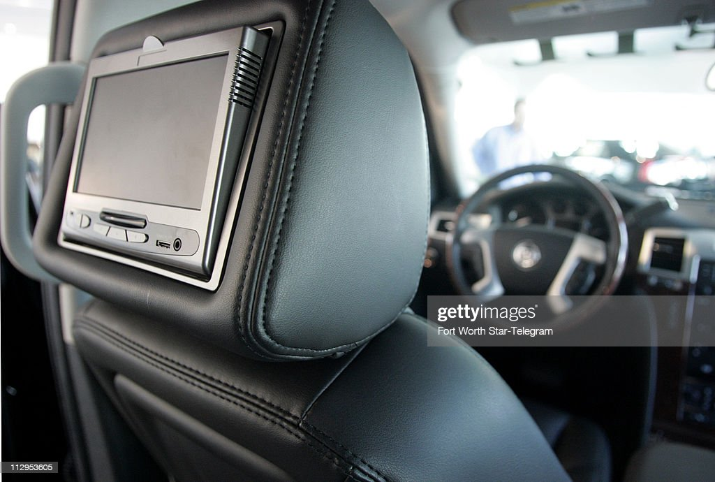 The Cadillac Escalade a DVD player in the headrest is shown on this model at a dealership in Grapevine Texas is the only large SUV showing in...