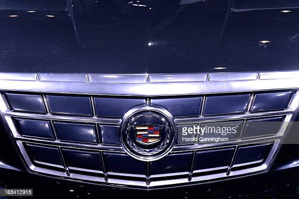 The Cadillac logo is seen during the 83rd Geneva Motor Show on March 6 2013 in Geneva Switzerland Held annually with more than 130 product premiers...
