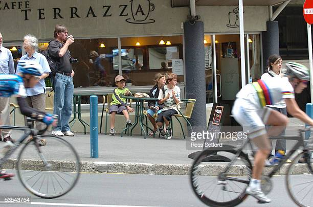 The cafe set applaud the cyclists in the Wellington leg of the Women's World Cup of Cycling race around the central city Wellington New Zealand...